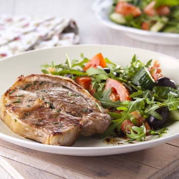 Grilled lamb steaks with salad